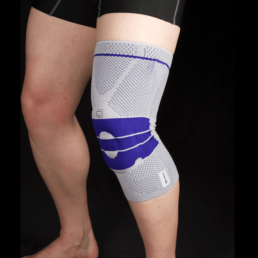 Man with knitted knee support