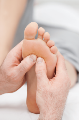 Foot getting massaged