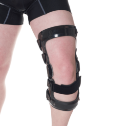 Man with 3D molded black knee orthosis