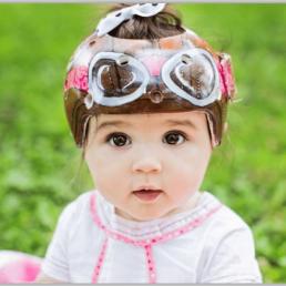 Baby with aviator medical helmet