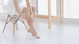 Woman holding legs